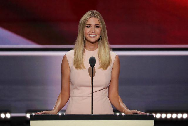 Ivanka Trump delivers a speech while wearing a pink dress.