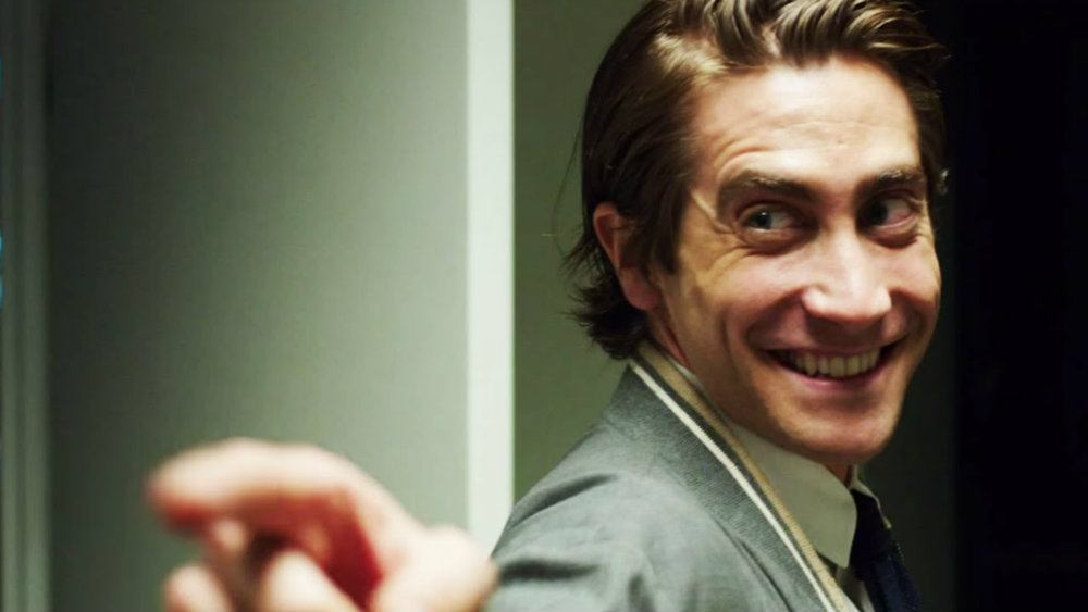 Jake Gyllenhaal points off screen in Nightcrawler