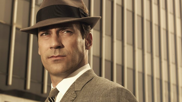 Jon Hamm is dressed in a suit and hat in Mad Men.