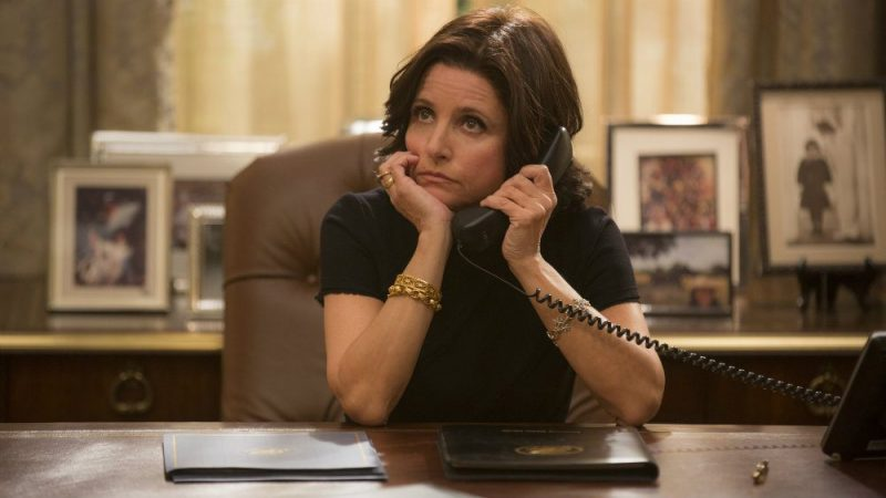 Julia Louis Dreyfuss in Veep on the phone at a desk