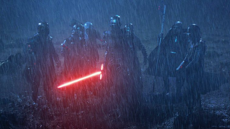 The Knights of Ren, gathered together in a rainstorm, clad in all black