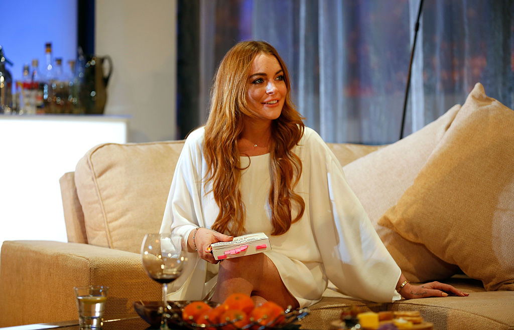 Lindsay Lohan performs during a photocall