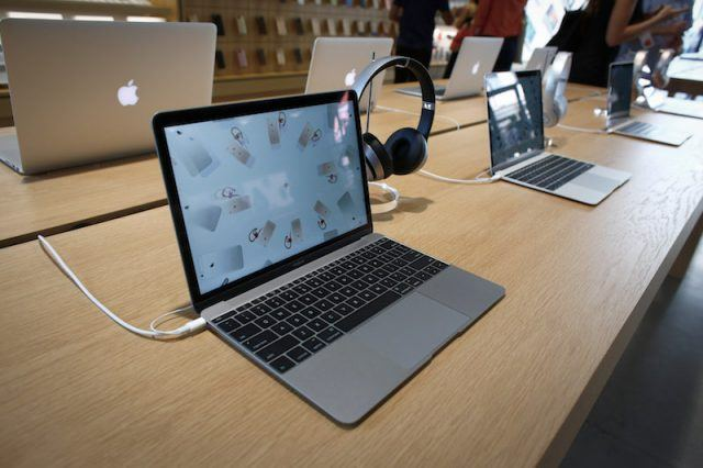 MacBook computers are displayed the new Brooklyn Apple Store during a media preview in the Williamsburg neighborhood of Brooklyn on July 28, 2016 in New York City. The Williamsburg Apple Store opens next Saturday on July 30th, it is a multi-use space with numerous wood cube seats and a giant 6K video screen.