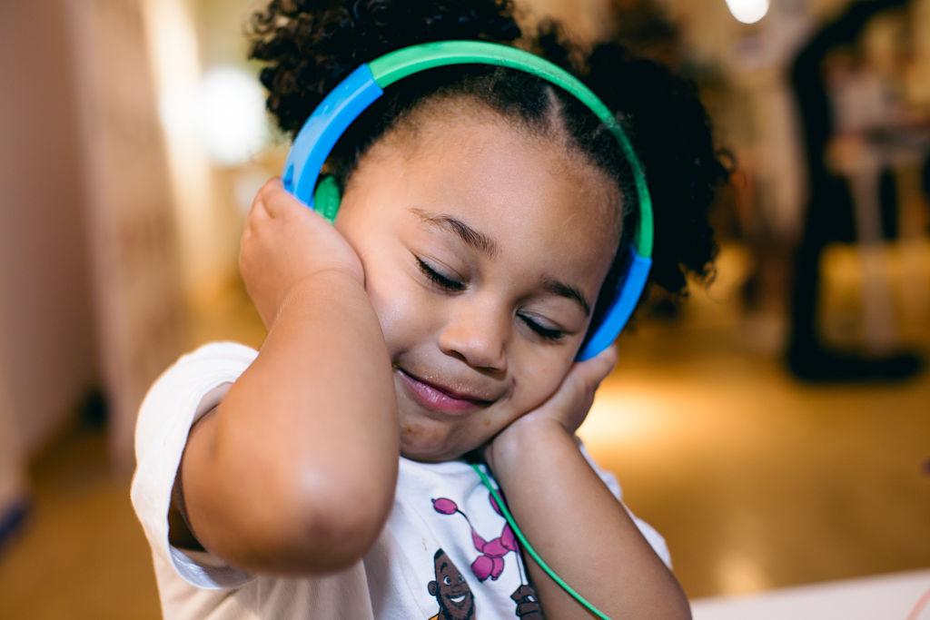 Austin Jett Rose Bennett poses with headphones