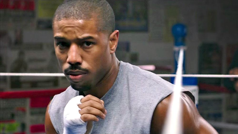 Michael B. Jordan boxing with his hands wrapped in Creed