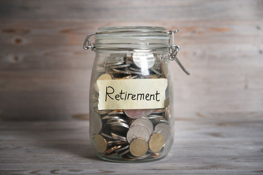 retirement label on jar filled with coins