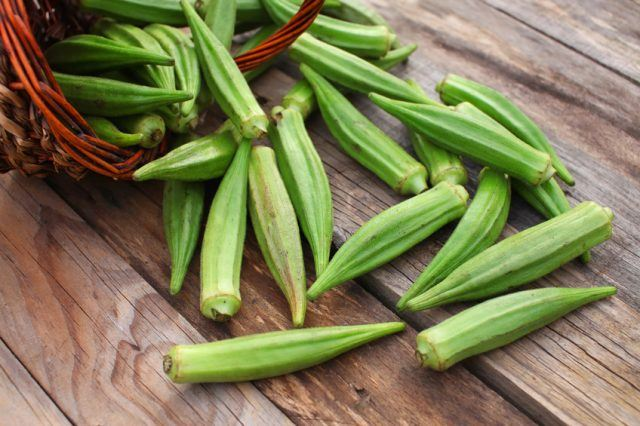Okra over wooden table