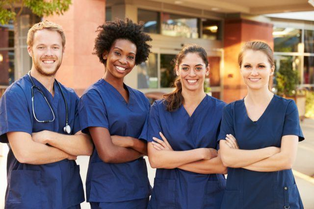Medical team standing outside medical facility