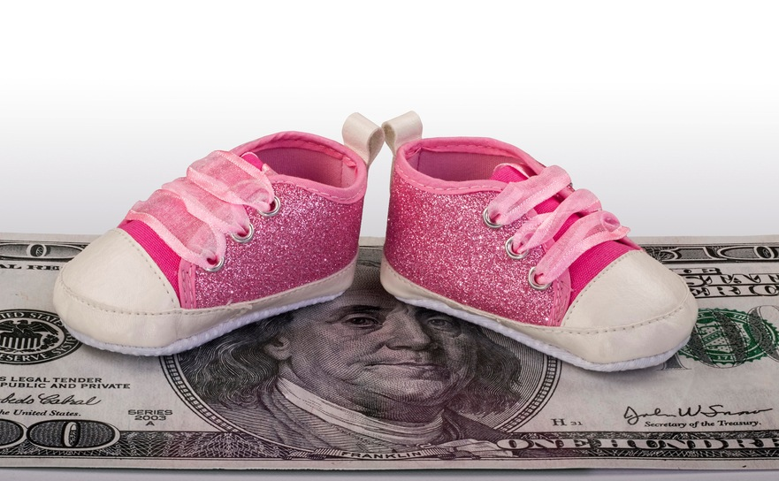baby shoes on $100 bill