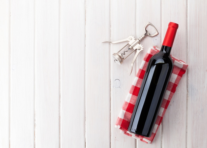 Red wine bottle and corkscrew