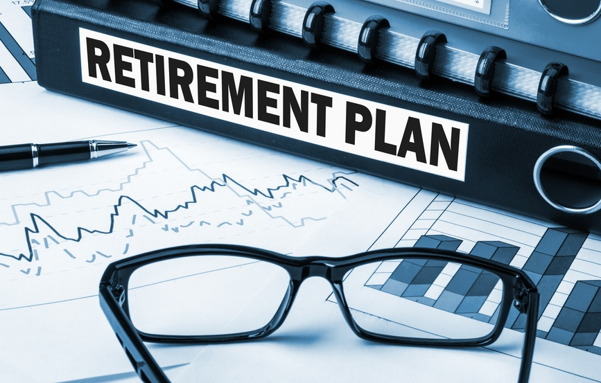 Retirement planning documents with graphs and glasses
