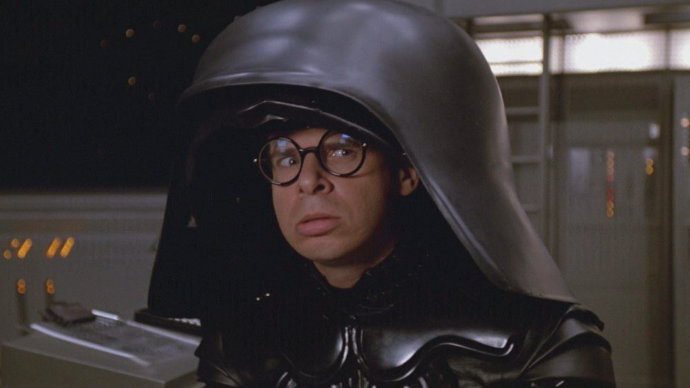 Rick Moranis in Spaceballs in a Darth Vader looking suit and helmet