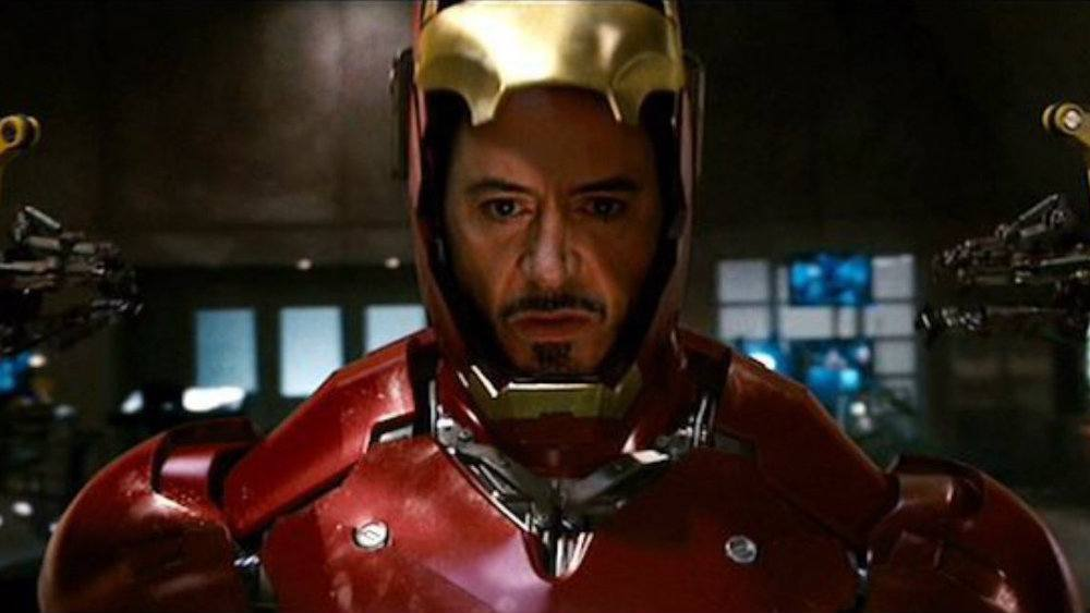 Robert Downey Jr in Iron Man in his suit looking angry