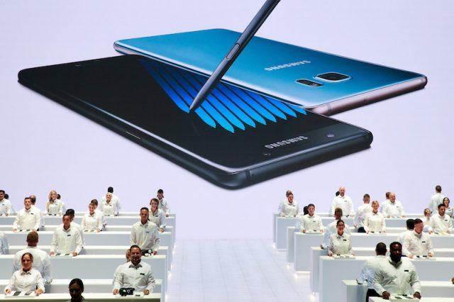 NEW YORK, NY - AUGUST 2: Samsung employees stand at display tables during a launch event for the Samsung Galaxy Note 7 at the Hammerstein Ballroom, August 2, 2016 in New York City. The stylus equipped smartphone will be available starting August 19, with preorders starting August 3.