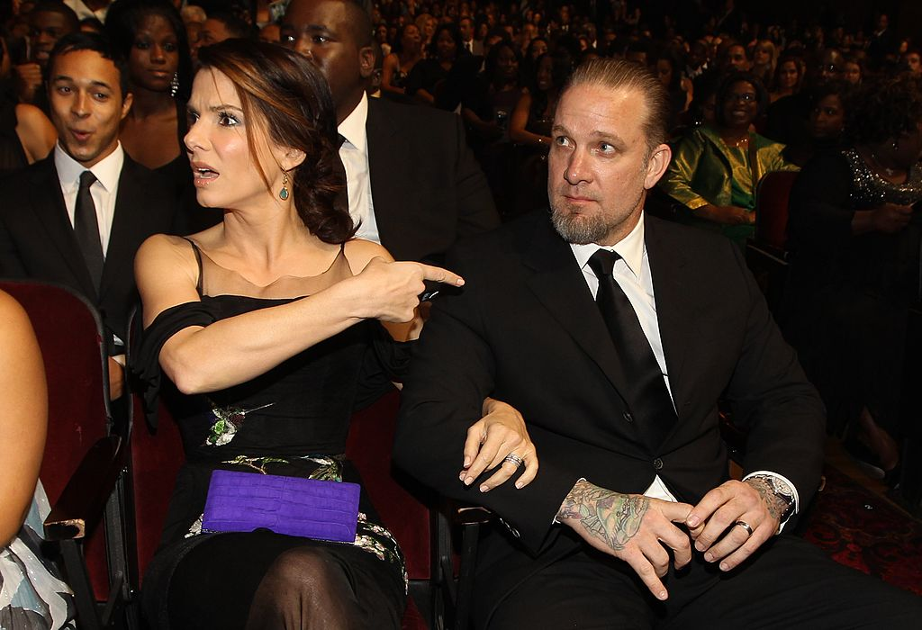 Actress Sandra Bullock points to husband Jesse James