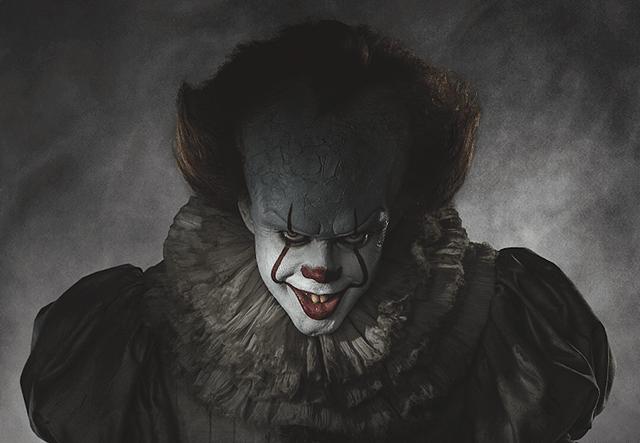 An evil clown stares ahead