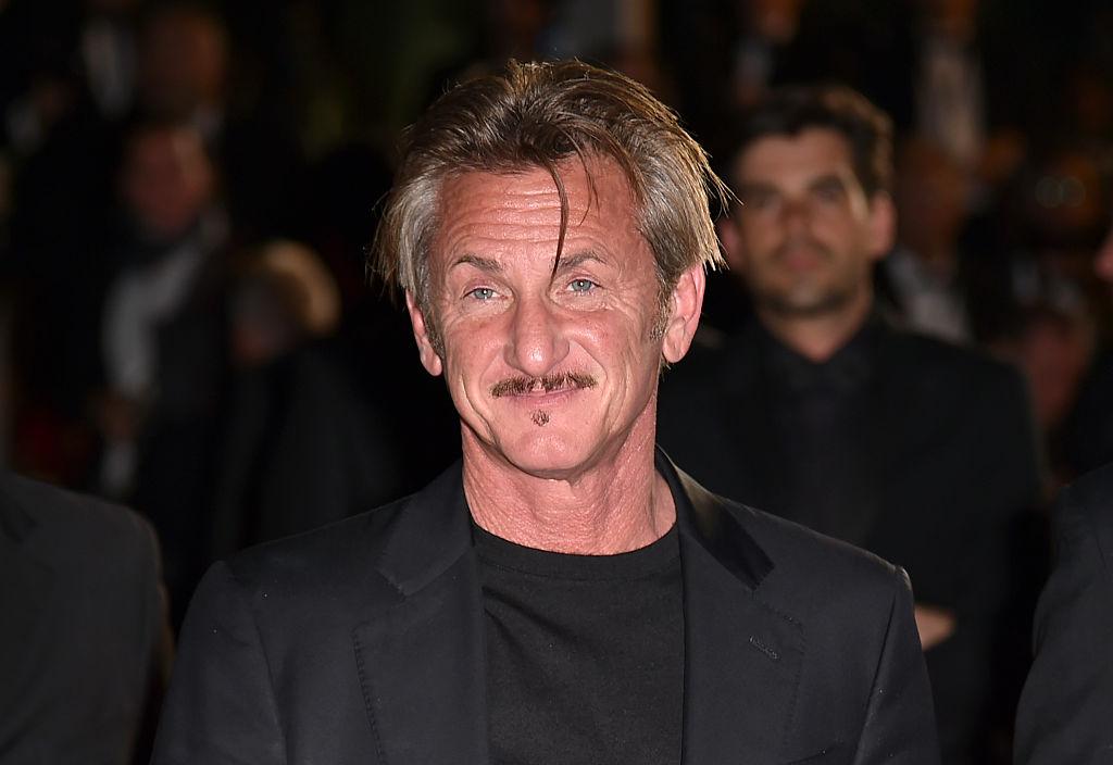 Sean Penn leaves the Festival Palace