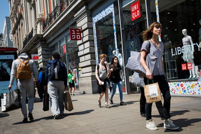 Shoppers carry bags with purchased clothes on Oxford Street on June 9, 2016 in London, England