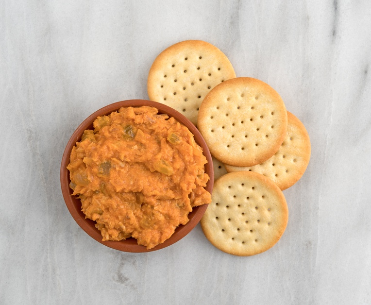 bowl of curried tuna salad with butter crackers
