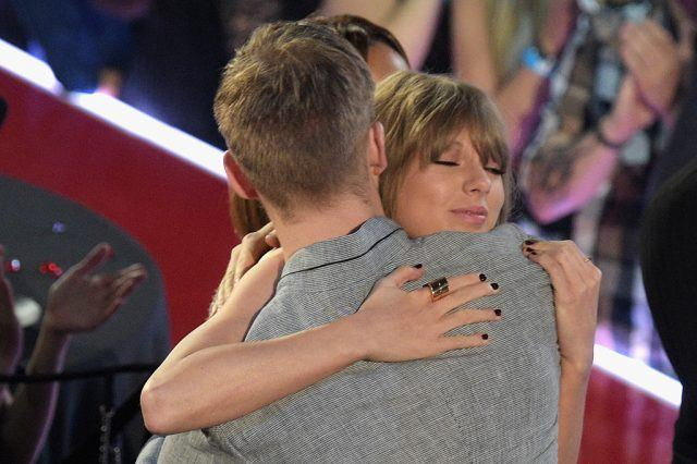 Taylor Swift hugs Calvin Harris at an awards show.