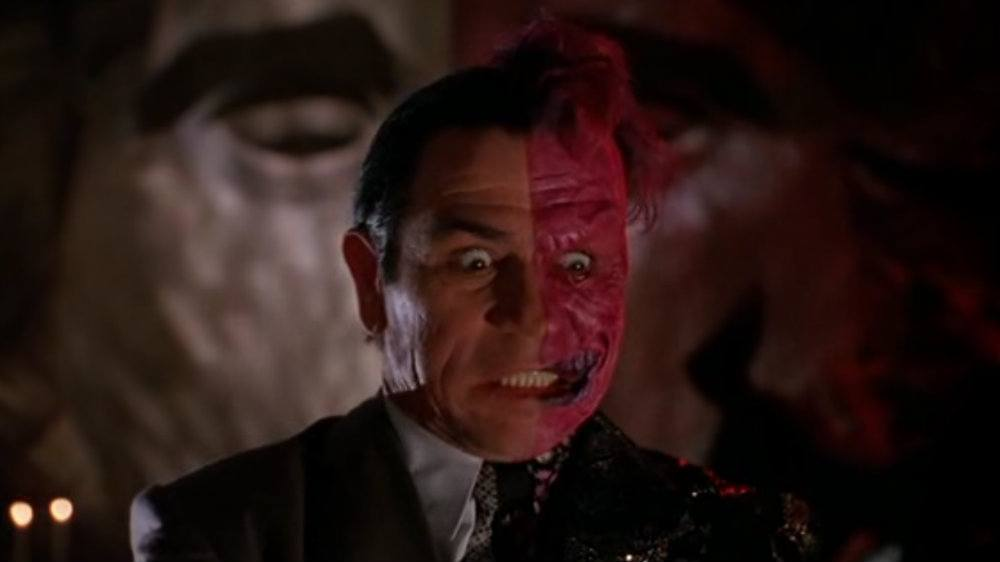Tommy Lee Jones has half of his face painted red in Batman Forever