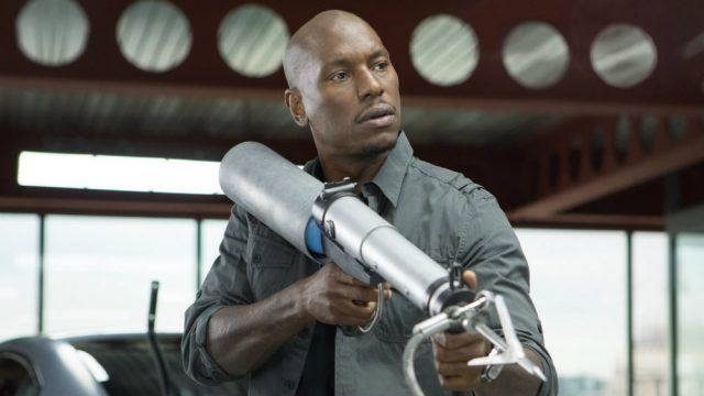 Tyrese Gibson holds up a piece of equipment in Fast and Furious 6