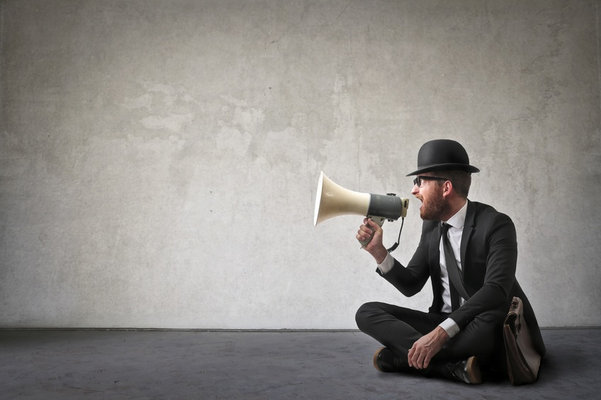 man shouting with a megaphone
