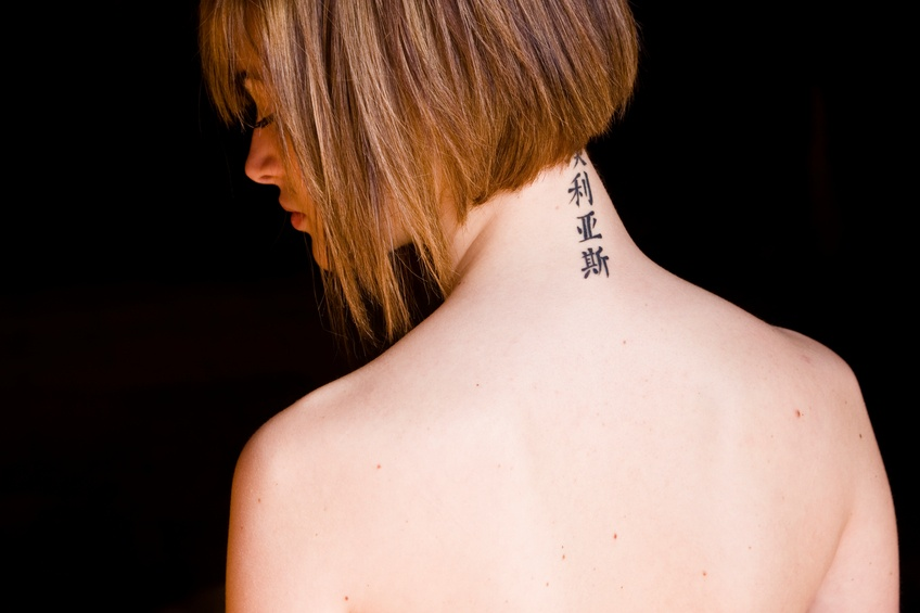 Woman with tattoo on the back