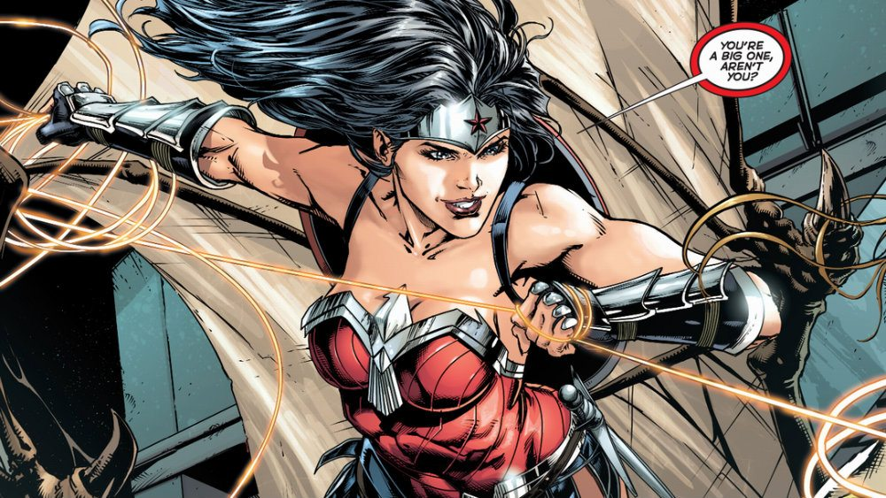Wonder Woman wielding her golden lasso and smiling