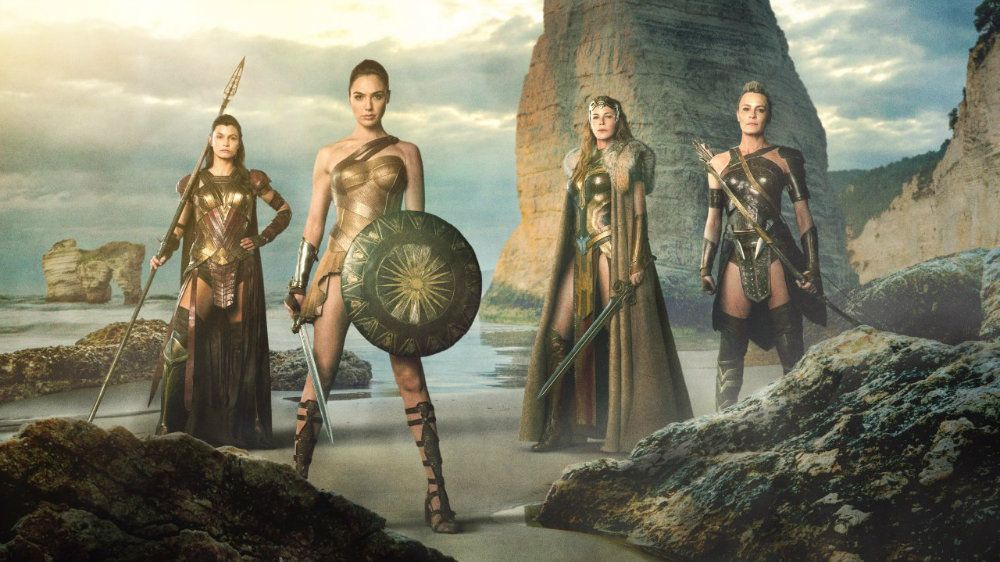 Four Amazons in armor standing posed for battle