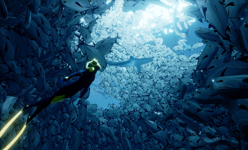 A diver swims into a school of fish in the game Abzu
