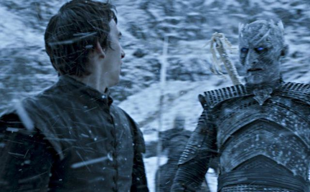 Bran looks over at the Night King while they stand in the snow.