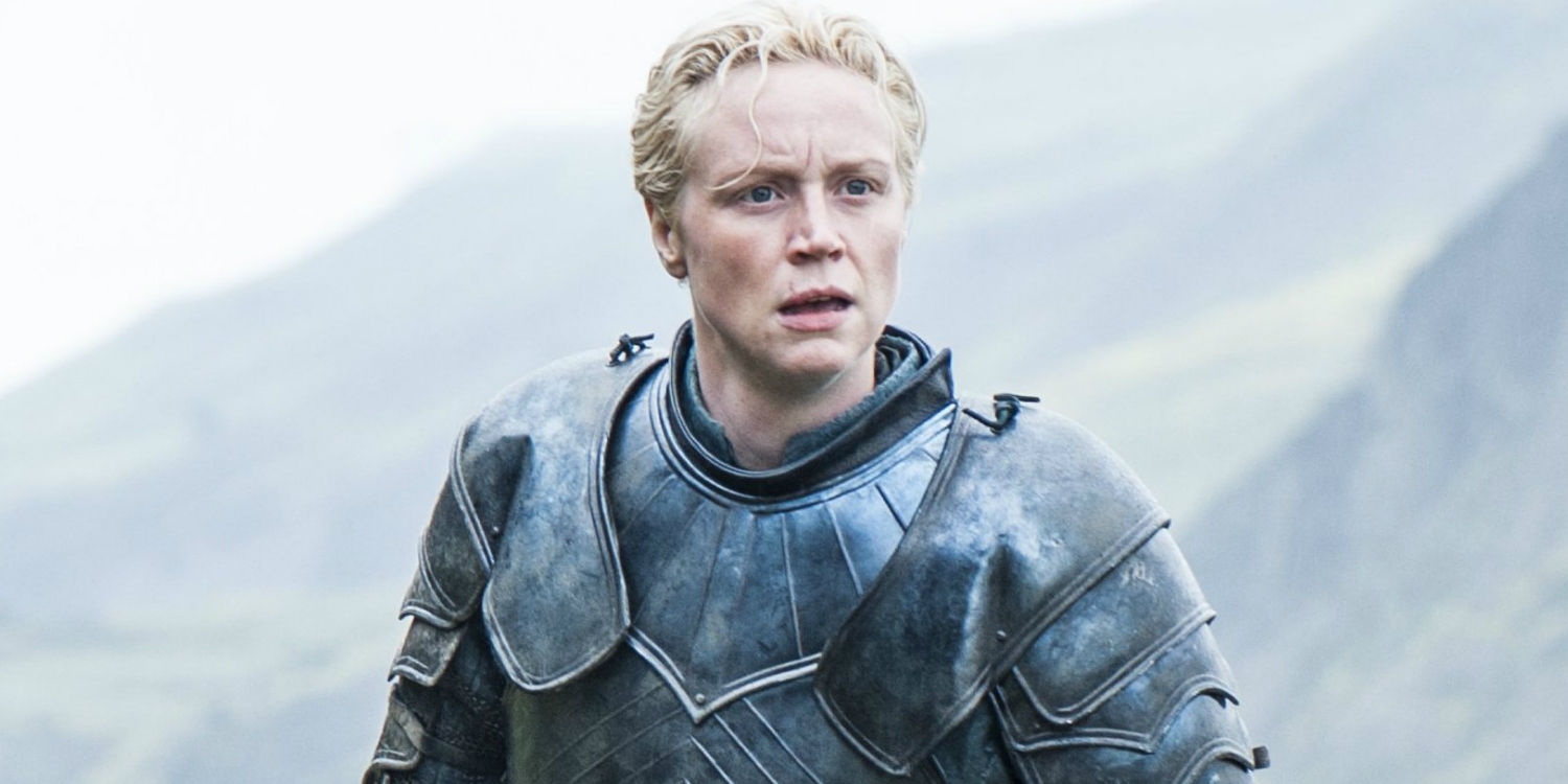 Lady Brienne, wearing armor and looking concerned off into the distance