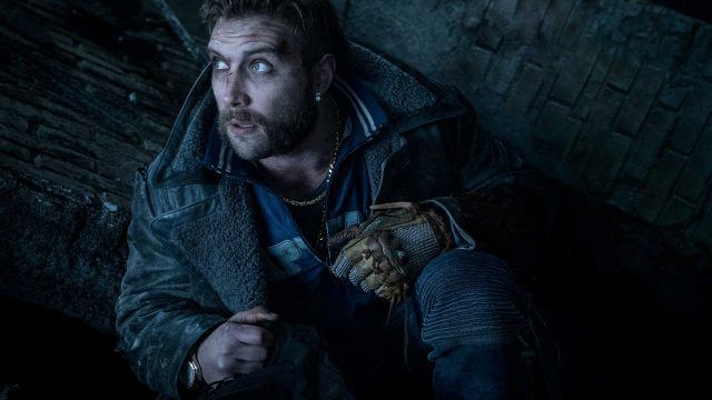 Captain Boomerang 'Suicide Squad' crouching down and looking to the side.