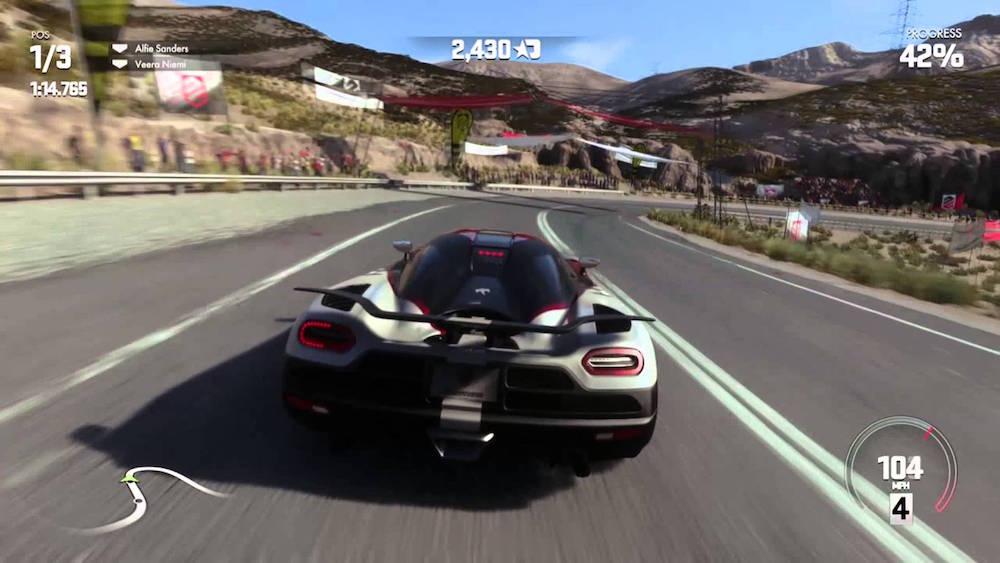 A car races along a track