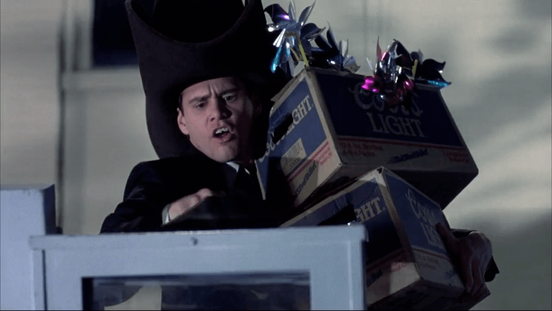 Lloyd Christmas holds boxes