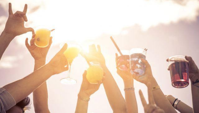 Labor Day, hands to the sky with cocktails