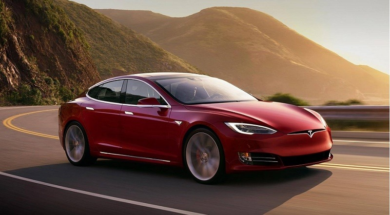 Road view of Tesla Model S P100D at sunset