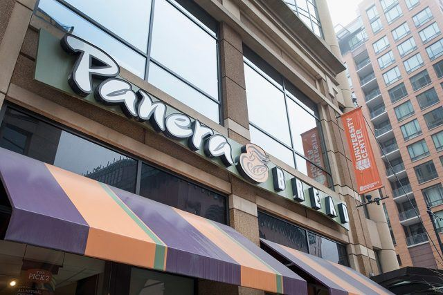 Panera storefront in front of a building.