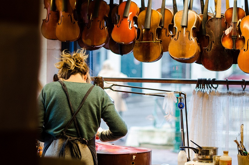 person working on stringed instruments