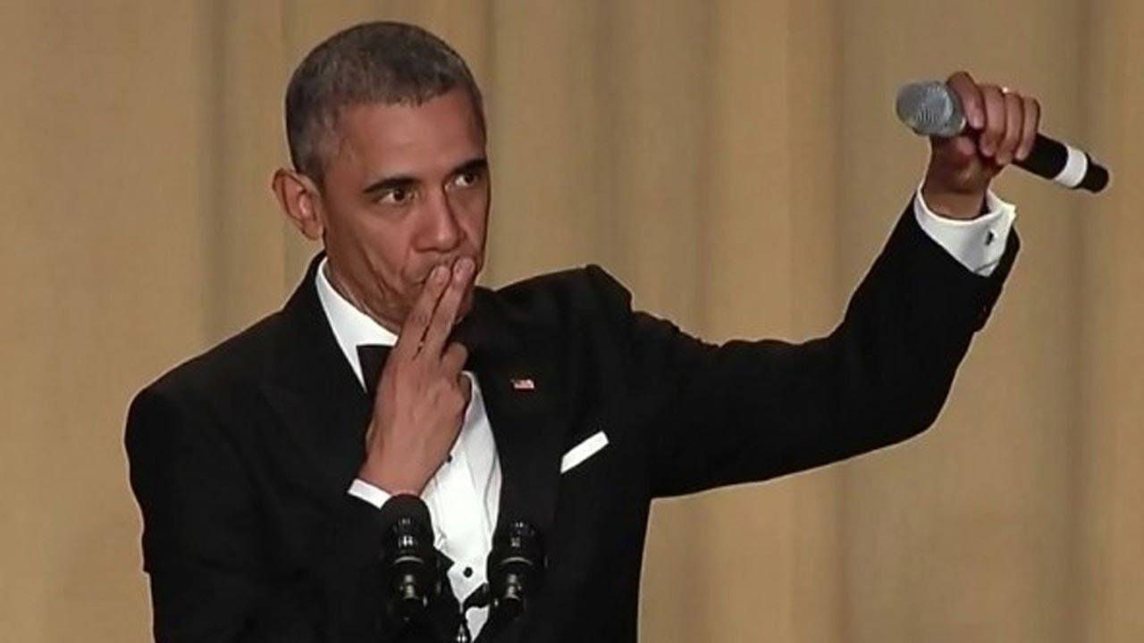 President Barack Obama bids adieu during a speech