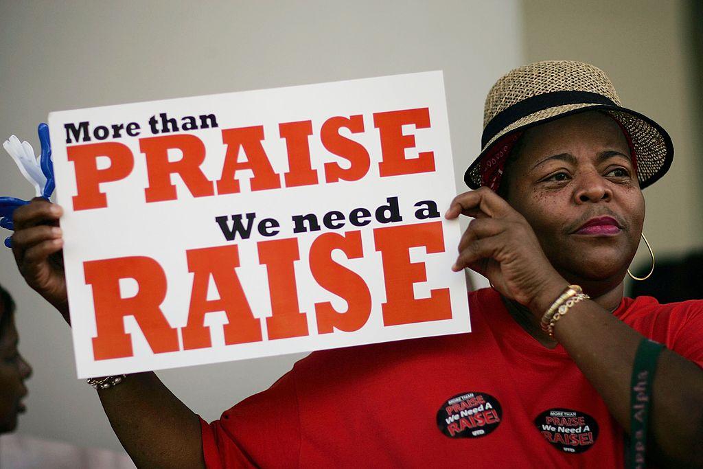 teacher protesting for a pay raise