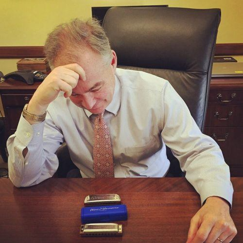 Time Kaine goffing off with his harmonica | Source: U.S. Senator Time Kaine via Facebook
