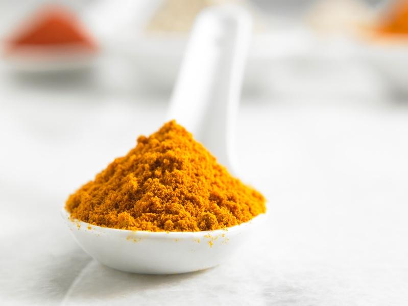 turmedic powder in a spoon