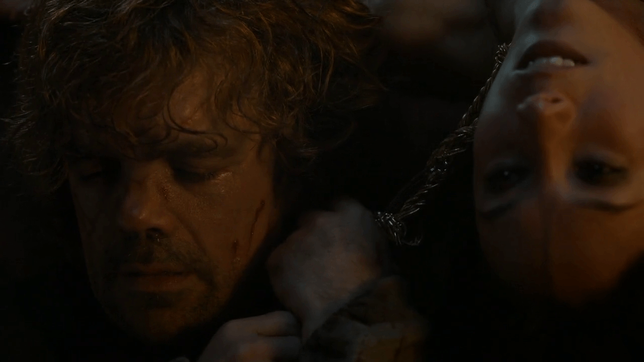 Tyrion sobs, as he pulls a chain around Shae's next, as she drapes off the end of the bed