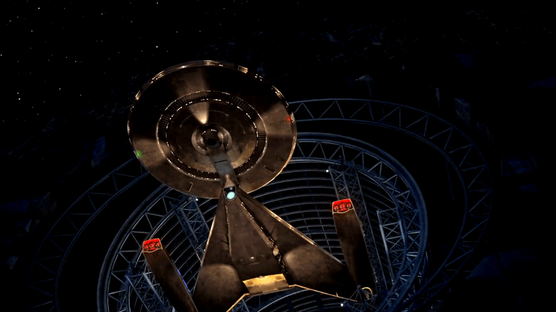 The starship USS Discovery, as seen from a low angle, flying out of a hangar