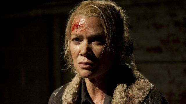 Andrea glares straight ahead with a forehead covered in blood.