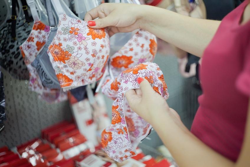 Woman checking bra in market