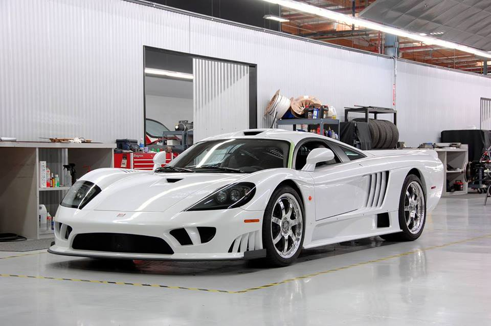 A Saleen S7 sits in a workshop