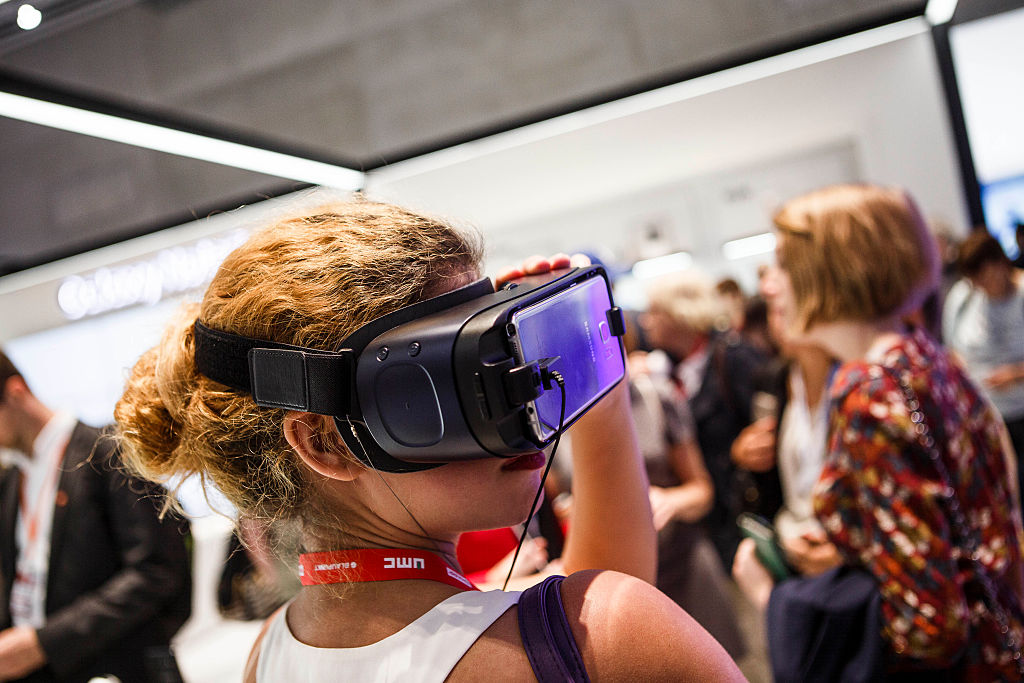 A visitor tries out virtual reality from Samsung at the 2016 IFA consumer electronics trade fair